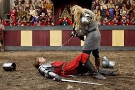 Morgause, beating up Arthur.